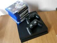 Ps4 500gb with ten games 2 controllers one charger cable and one hdmi cable