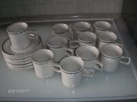 Brand new Coffee Cups & Saucers. 11 of each. White with silver border