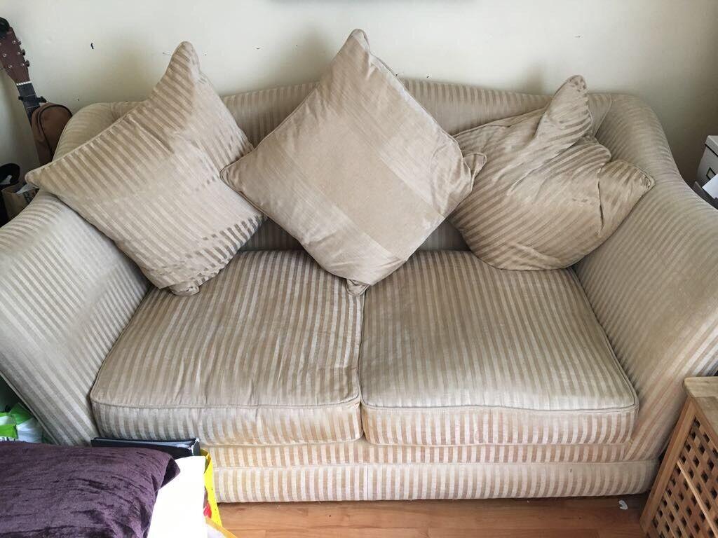 Large 2 seater cream sofa