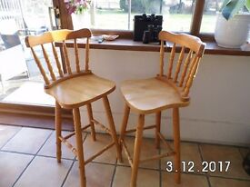 Two wooden bar stools in very good condition - Reduced for quick sale.