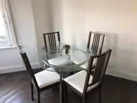 **Brand New Modern Dining Table + 4 Chairs**