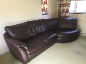 Brown leather corner sofa. Seats four people