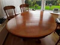 Circular 4ft dining table extends to a 6ft