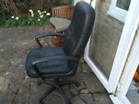 Office Manager's Black leather high back swivel chair.