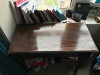 Dark wood desk with drawer