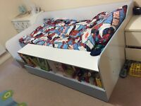 Single low sleeper bed with bookcase and underbed drawers