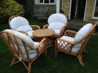 Four wicker chairs and table. Conservatory furniture