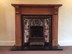 Wood and Tiled and Cast Iron, art noveau style gas fire and surround.