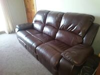 Brown leather Recliner sofa.