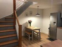 Grey and wooden dining table and benches
