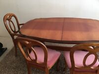 Dining table and 6 chairs made from cherry wood.