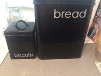 Black metal and black metal biscuit tin
