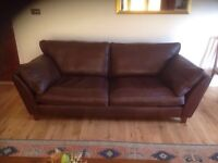 Large brown soft leather sofa for sale.