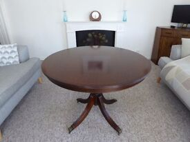 Mahogany round tilt-top dining table and 4 matching chairs