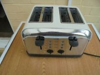 logic 4 slice toaster. new and unused in packaging.