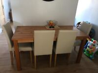 Oak effect dining table with four leather look chairs