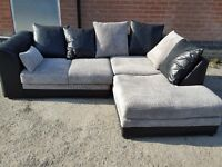 Stunning black and grey cord corner sofa. 1 month old. as new. clean and tidy. can deliver