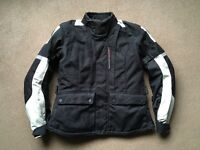 Rev'it Ladies Textile Motorcycle Suit. Waterproof/breathable. Used twice with tags. As new condition