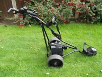 Powakaddy Freeway golf trolley with battery and charger.
