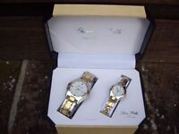 Watch gift set his n hers in gold and steel in gift box.