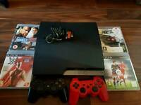 Playstation 3 with 2 controlers and 4 games