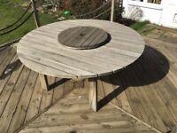 Round garden table: pressure-treated pine.