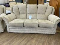 Beige three seater sofa and armchair
