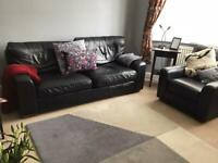 S5 area of Sheffield. Black leather sofa and armchair in vgc. M&S .