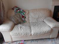 Cream leather-like sofa