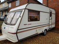 Bailey magenta caravan with full awning