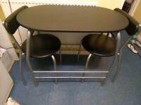Brand new space saver table and 2 chairs