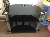 """Black glass corner TV stand takes up to 42"""" LED TV ( slight scratches on lower shelf)"""