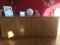 Two double base cupboards currently being used as a sideboard