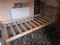 Single bed with sliding guest bed underneath