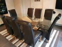 Galss dining table with 8 leather chairs