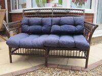 Conservatory cane sofa