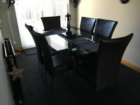 Glass dining table and 6 leather chairs