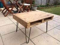 Wooden recycled pallet table with retro pin legs