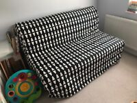 Ikea double sofa bed with geometric print cover and large blanket box