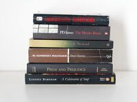 A bundle of books, novels in black and brown, for your instant library.