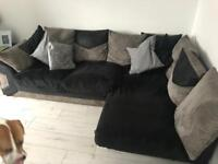 Grey and black corner couch and pouffe