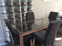 AS NEW glass table and chairs