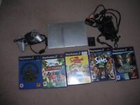 Playstation 2 with 8mb memory card and 5 games