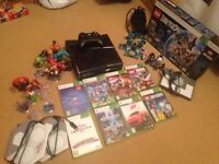 Xbox 360 plus Disney infinaty and Lego dimensions
