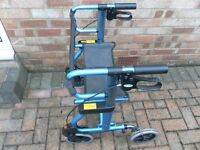 Wheeled Mobility walker aid with seat