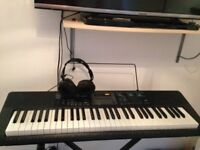 Casio E lectric Keyboard with stand and headphone