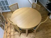 Round dining table with four chairs (RRP £480)