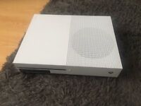 microsoft xbox one s white console with game and controller