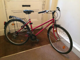 Beloved red bike for sale due to move overseas