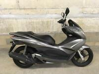 Honda PCX 125 (great for learners or couriers)